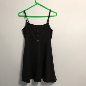 Black skater dress with buttons